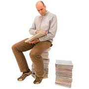 Photo: Man sitting on books