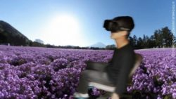 Image: Virtual reality background with a wheelchair user wearing virtual reality glasses; Copyright: TOYOHASHI UNIVERSITY OF TECHNOLOGY