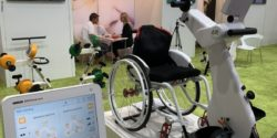 Photo: The MOTOmed loop for wheelchair user at the RECK booth at REHACARE 2019; Copyright: beta-web