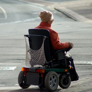 Photo: Elderly woman in an electric wheelchair