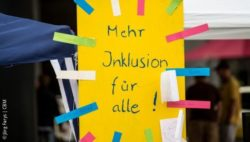 "Photo: A poster that says ""More Inclusion for all""; Copyright: Jörg Farys 